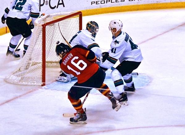 Aleksander Barkov scoring a goal on San Jose goaltender Antti Niemi