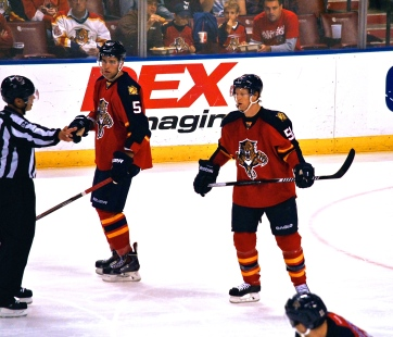 Aaron Ekblad and Brian Campbell awaiting a faceoff