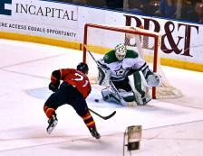 Vincent Trocheck taking a shot on Dallas goaltender Kari Lehtonen