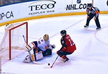 Jonathan Huberdeau scoring a shootout goal on New York Islanders goaltender Jaroslav Halak