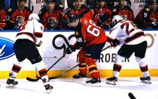 Jaromir Jagr battling two New Jersey Devils players