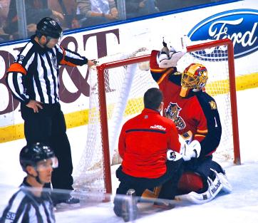 Luongo flexing his arm after being injured in a game vs. the Maple Leafs